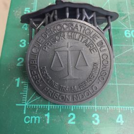 Fabricated prison militaire button
