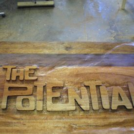 The Potential Wooden signboard
